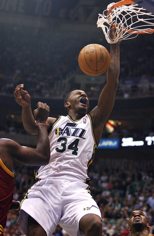 Djamila Grossman  |  The Salt Lake Tribune  The Utah Jazz's C.J. Miles, 34,  dunks the ball in a game against Cleveland in Salt Lake City, Friday, Jan. 14, 2011.