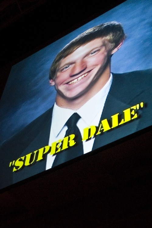 Chris Detrick  |  The Salt Lake Tribune  A picture of Dale Lawrence is projected during the senior night ceremony before the wrestling match at Wasatch High School Thursday January 13, 2011.  Wrestler Dale Lawrence was injured during a wrestling practice January 4.