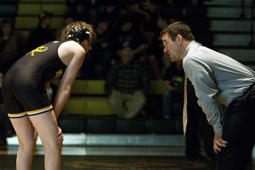 Chris Detrick  |  The Salt Lake Tribune  Aryan Shibonis talks with coach Wade Discher during the wrestling match at Wasatch High School Thursday January 13, 2011.  Wrestler Dale Lawrence was injured during a wrestling practice January 4.