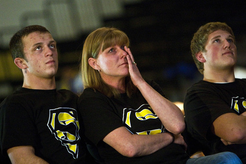 Chris Detrick  |  The Salt Lake Tribune  (L-R) Tyler Mair, Kelly Giles and Tyson Kohler watch a video of Dale Lawrence's wrestling career during the senior night ceremony before the wrestling match at Wasatch High School Thursday January 13, 2011.  Wrestler Dale Lawrence was injured during a wrestling practice January 4.