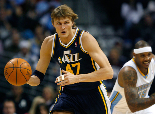 Steve Griffin  |  The Salt Lake Tribune  Utah Jazz forward Andrei Kirilenko heads up court ahead of Denver Nuggets forward Carmelo Anthony during first half action of the Jazz season opening game against the Nuggets at the Pepsi Center  in Denver Wednesday, October 27, 2010.