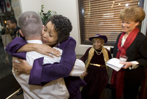Al Hartmann  |  The Salt Lake Tribune  Dr. Jackie Thompson, left,  hugs a friend during social hour for the Drum Major Awards Luncheon sponsored by the Utah State Martin Luther King Jr. Human Rights Commission held Friday January 14th at the West Valley City Cultural Celebration Center.   She was one of the recipients of an award.  Ruby Price and Treesa Edgar look on.