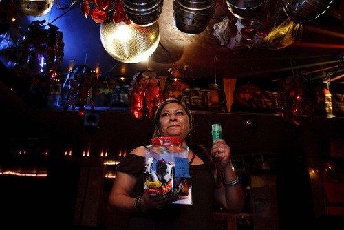 Trent Nelson     The Salt Lake Tribune Alicia Martinez holds a jar filled with packets of lubrication at the Durango Nightclub. The patron who guessed the correct number of packets won a prize. The Utah Department of Health was on hand offering free HIV tests at the Durango Nightclub in December.