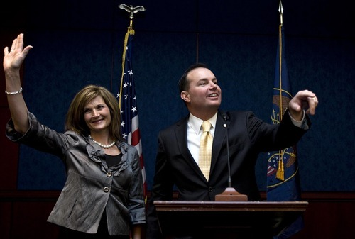 Djamila Grossman  |  The Salt Lake Tribune Sen. Mike Lee, R-Utah, and his wife, Sharon, wave after he was sworn in on Capitol Hill on Jan. 5. The shadowy group Utah Defenders of Constitutional Integrity sent a mailer to delegates in the days before the pivotal state convention, making it appear as if Lee was using his Mormon faith in an attack against former Sen. Bob Bennett, who also is LDS.