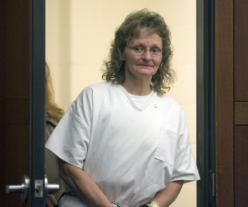 Al Hartmann  |  The Salt Lake Tribune  POOL PHOTO Debra Brown enters Judge Michael DiReda's 2nd District Court in Ogden Tuesday January 18th.  She is the first Utah inmate to try a new state law that allows for non DNA innocence claims.