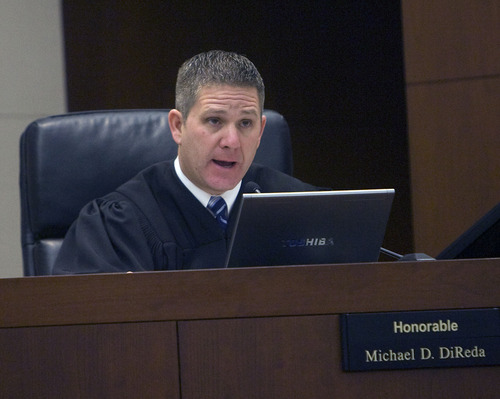 Al Hartmann  |  The Salt Lake Tribune  POOL PHOTO  Judge Michael DiReda talks with lawyers  Tuesday January 18th during the beginning of the Debra Brown trial.  Brown is the first Utah inmate to try a new state law that allows for non DNA innocence claims.