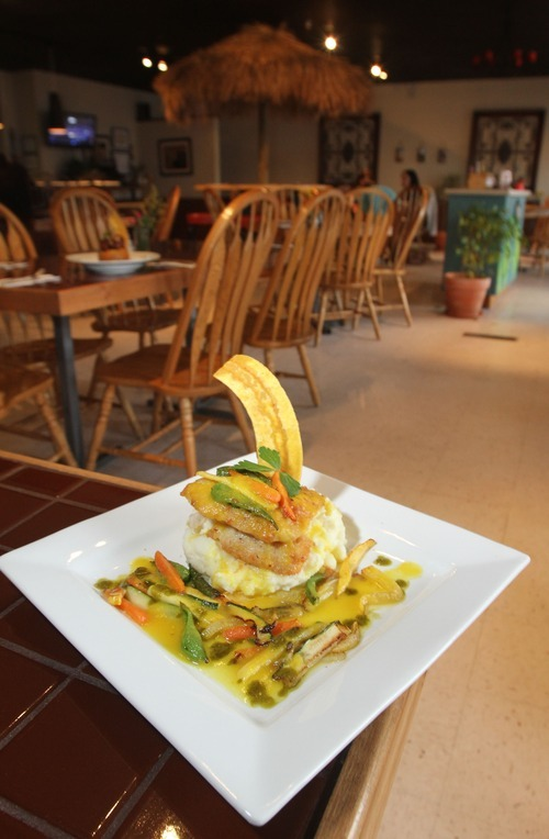 Rick Egan      The Salt Lake Tribune  Red snapper fillet over mashed potatoes, vegetables and yellow bell pepper coulis at Adobos Caribbean Grill in Sandy.