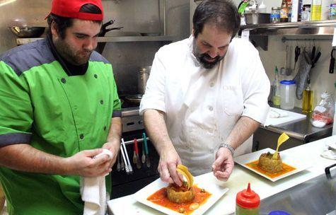 Rick Egan      The Salt Lake Tribune   Brandon Mena and chef Hermes Vargas prepare a traditional Puerto Rican mofongo dish at Adobos Caribbean Grill in Sandy.