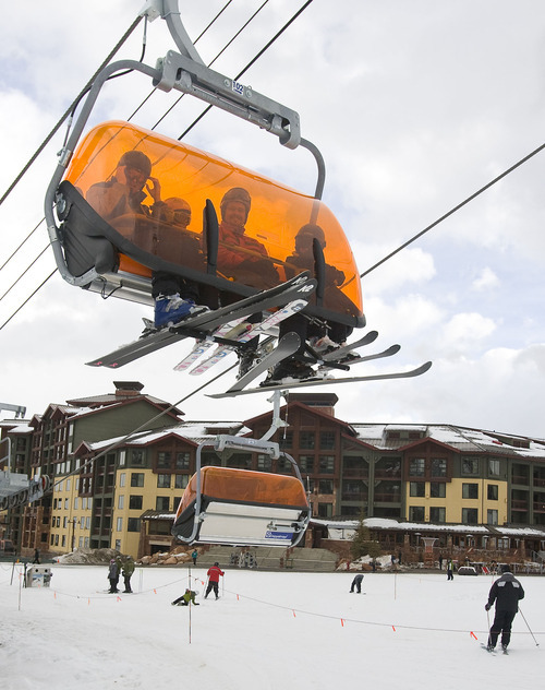 Al Hartmann  |  The Salt Lake Tribune  Skiers take the new heated Orange Bubble Express chairlift from the base of the Mountain at Canyons Resort on Monday afternoon.