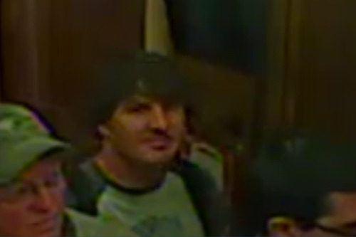 These are the photos released by Salt Lake City police of the accused BASE jumpers as they rode in the elevator at the LDS Church Office Building on Nov. 12. This man is believed to be Marshall Miller.