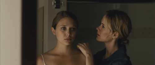Martha (Elizabeth Olsen, left) returns to her sister Lucy (Sarah Paulson) after a mysterious absence in the drama