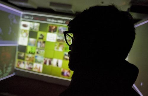 Djamila Grossman  |  The Salt Lake Tribune  A man looks at the Lance Weiler's installation,