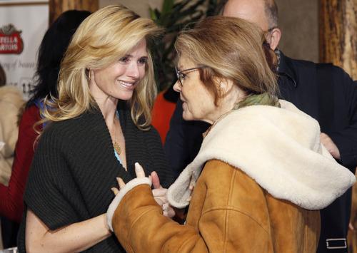 Director Jennifer Siebel Newsom, left, talks with activist Gloria Steinem at the premiere of