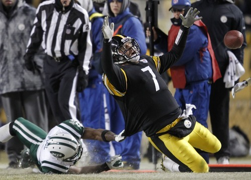 Pittsburgh Steelers quarterback Ben Roethlisberger (7) is dragged down by New York Jets safety Brodney Pool after a run during the second half of the AFC Championship NFL football game in Pittsburgh, Sunday, Jan. 23, 2011. (AP Photo/Gene J. Puskar)