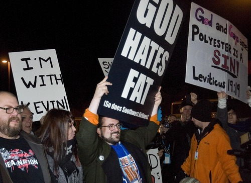 Djamila Grossman     The Salt Lake Tribune  Director Kevin Smith and supporters holds signs as they face off with protesters before the premiere of his movie