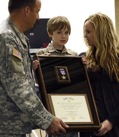 Leah Hogsten | The Salt Lake Tribune Jase Spargur (center) is presented with his father's Silver Star during a ceremony in April 2009.