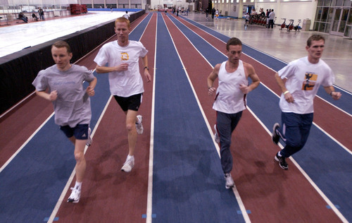 The track at Utah Olympic Oval in Kearns has become a popular workout site for casual and elite runners, including Matt Harmer, Corbin Talley, Joe Wilson and Trevor Pettingill, from left. Tribune file photo by Francisco Kjolseth