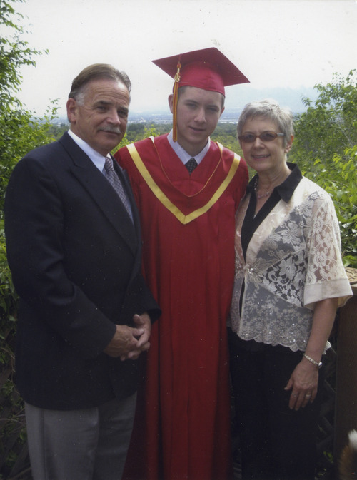 Courtesy Starks family George and Jane Starks of Salt Lake City with son Michael at Judge Memorial High School's graduation in 2008. Michael Starks died of acute alcohol poisoning on Nov. 21, 2008, in a hazing incident at Utah State University.