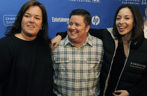 Rosie O'Donnell, left, curator of the Oprah Winfrey Network's non-fiction films, poses with Chaz Bono, center, subject of the OWN documentary film