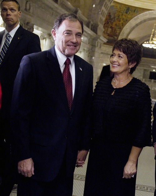 Utah Governor Gary R. Herbert, along with his wife Jeanette Herbert, arrives Wednesday at the Utah House of Representatives chamber to give the State of the State address at the Capitol. Mike Terry  |  The Associated Press