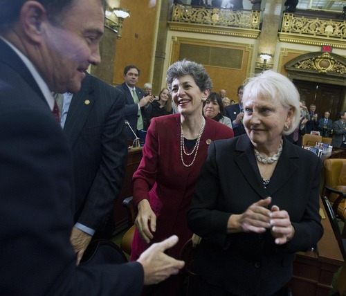 Utah Gov. Gary R. Herbert, left,  arrives Wednesday at the Utah House of Representatives chamber and greets Rep. Patrice Arent, second from left, and Sen. Karen Mayne before giving the State of the State address at the Capitol. Mike Terry  |  The Associated Press