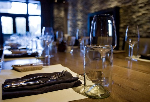 Djamila Grossman     The Salt Lake Tribune The stone-rich, neutral-toned décor is luxe at J & G Grill at Deer Valley. The views are stunning. And when the food is a hit, it's sublime. Mussels mariniere, tai snapper in sweet and sour jus and salted caramel popcorn sundae are memorable.    A table is set at the J&G Grill at St. Regis Deer Valley Resort, Friday, Jan. 21, 2011.