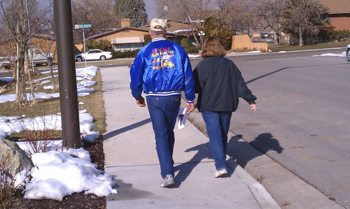 Cimaron Neugebauer  |  The Salt Lake Tribune Nate Johnson, a volunteer, walks with his wife, Donna, in a neighborhood in Springville to talk to people about missing boy  Chad Stilson on Saturday. More than 250 volunteers canvassed the neighborhood and distributed flyers to raise awareness of the 12-year-old boy.