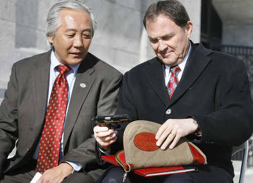 Scott Sommerdorf  l  The Salt Lake Tribune Rep. Curt Oda, R-Clearfield, leans in to talk to Gov. Gary Herbert about the commemorative Browning handgun given to the governor by Christopher Browning, the great grandson of John M. Browning. The governor made a formal presentation of the resolution declaring Jan. 24 as John M. Browning Day during the noon ceremony on the Capitol steps.