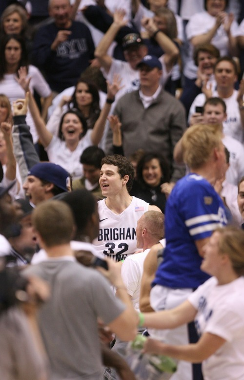 Steve Griffin  |  The Salt Lake Tribune   BYU guard Jimmer Fredette is all smiles as the fans storm the court following BYU's victory over San Diego State men's basketball game at the Marriott Center in Provo Wednesday, January 26, 2011.