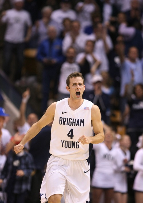 Steve Griffin  |  The Salt Lake Tribune   BYU guard Jackson Emery screams as he runs up the court after dunking the ball during second half action of the BYU versus San Diego State men's basketball game at the Marriott Center in Provo Wednesday, January 26, 2011.