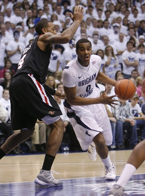 Steve Griffin  |  The Salt Lake Tribune   BYU forward Brandon Davies drives into the lane during first half action of the BYU versus San Diego State men's basketball game at the Marriott Center in Provo Wednesday, January 26, 2011.