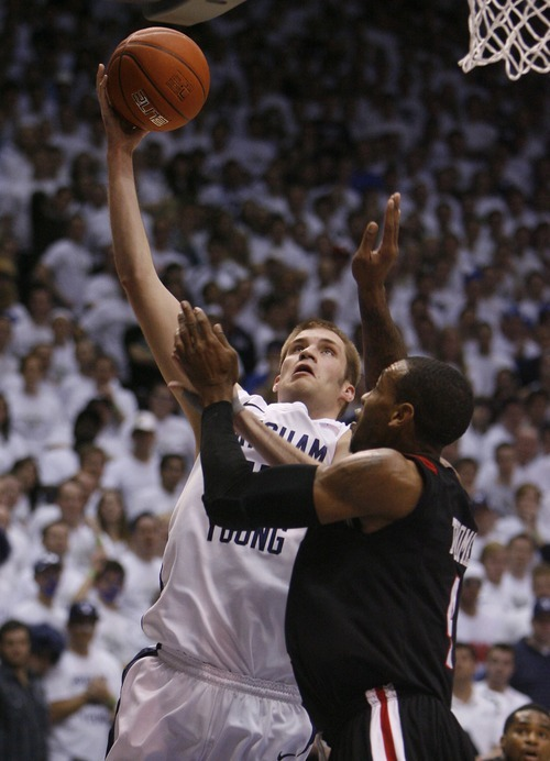 Steve Griffin  |  The Salt Lake Tribune   BYU forward James Anderson shoots over San Diego State forward Malcolm Thomas during first half action of the BYU versus San Diego State men's basketball game at the Marriott Center in Provo Wednesday, January 26, 2011.