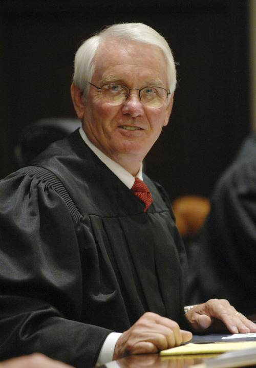 In a July 27, 2007 photo, Senior U.S. District Judge Roger Vinson speaks to candidates for citizenship during a naturalization ceremony at the U.S. District Court in Pensacola, Fla.  Vinson declared the Obama administration's health care overhaul unconstitutional Monday, Jan. 31, 2011, siding with 26 states that sued to block it, saying that people can't be required to buy health insurance.  (AP Photo/Pensacola News Journal, Ben Twingley)