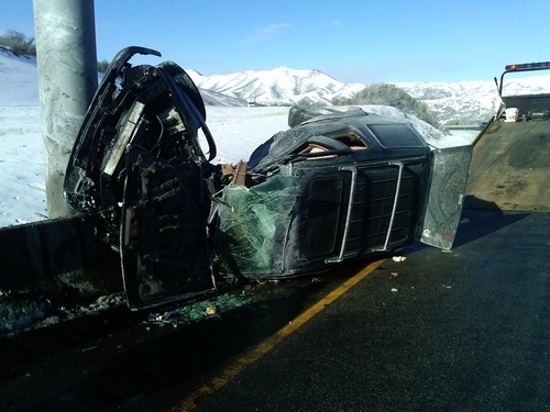 Courtesy of Utah Highway Patrol A 20-year-old Heber City man was injured Tuesday morning in a rollover accident near Summit Park. He allegedly lost control of his SUV while speeding, struck a sign and rolled the vehicle.