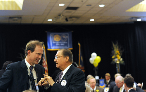 Sarah A. Miller  |  The Salt Lake Tribune Rotarians Tom Thatcher and Vince Breglio socialize during a Tuesday luncheon celebrating the Rotary Club of Salt Lake City's 100th anniversary. The club has promoted numerous civic-enhancement projects over the past century, from road building to the eradication of polio.
