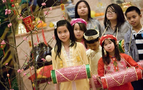 Djamila Grossman  |  The Salt Lake Tribune The Vietnamese Community in Utah is celebrating the lunar New Year with a big festival. From left: Nhu Tran, 10, Rose Nguyen, 8, Amy Nguyen, 12, VT Nguyen, 9, Lan Anh Vu, 7, Anne Nguyen, 10, and Dean Pham, 10, gather at Lien Hoa Buddhist Temple in Taylorsville Sunday to practice a dance they will be performing during the festival.