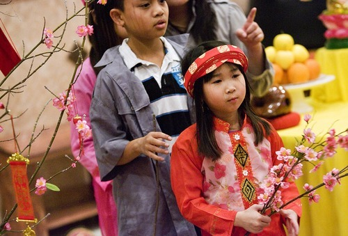 Djamila Grossman  |  The Salt Lake Tribune The Vietnamese Community in Utah is celebrating the lunar New Year with a big festival. Lan Anh Vu, 7, and Dean Pham, 10, rehearse Sunday at Lien Hoa Buddhist Temple in Taylorsville.
