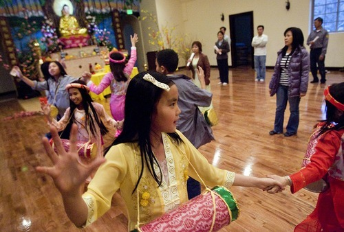 Djamila Grossman  |  The Salt Lake Tribune The Vietnamese Community in Utah is celebrating the lunar New Year with a big festival. Nhu Tran, 10, and other children gather Sunday at Lien Hoa Buddhist Temple in Taylorsville to practice dance that they will be performing during the Tet celebration.