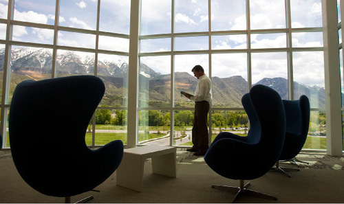 Al Hartmann  |  The Salt Lake Tribune file photo   Stuart Dean, director for APX Alarm Security Solutions Inc.'s public relations, takes in the view from the company library. Provo-based based company has changed its name and expanded its business to begin offering home automation equipment and services. Rapidly growing APX Alarm is now known as Vivint, a combination of