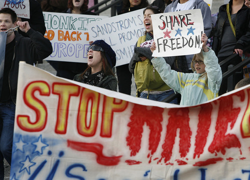 SCOTT SOMMERDORF l The Salt Lake Tribune Some 150 to 200 people showed up for a rally for Immigrant rights on the front steps of the Utah State Capitol, Monday. Those participating warned against Utah adopting an Arizona-style bill that would require local police to check immigration status.