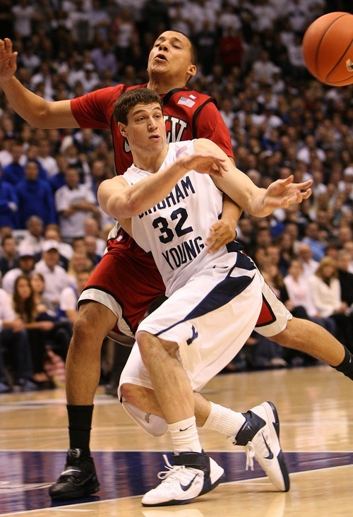 Leah Hogsten  |  The Salt Lake Tribune UNLV guard Derrick Jasper (5) runs into BYU guard Jimmer Fredette (32). The Brigham Young University Cougars defeated UNLV Saturday, February 5, 2011, in Provo, 78-64 at the Marriott Center.