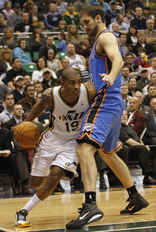 Rick Egan   |  The Salt Lake Tribune  Utah Jazz guard Raja Bell (19) tries to get past Oklahoma City Thunder's Nenad Krstic (12) in NBA action, Utah Jazz vs. Oklahoma Thunder, in Salt Lake City,  Saturday, February 5, 2011
