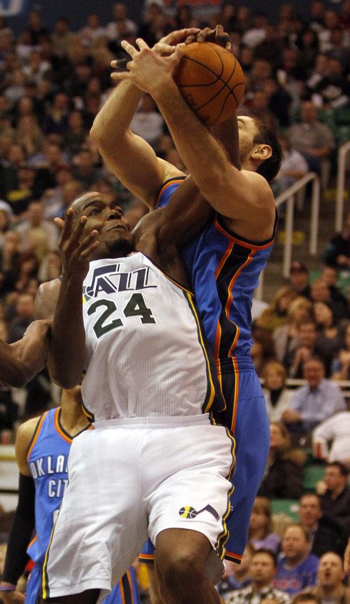 Rick Egan   |  The Salt Lake Tribune  Utah Jazz forward Paul Millsap (24)   is fouled by Oklahoma City Thunder's Nenad Krstic (12), in NBA action, Utah Jazz vs. Oklahoma Thunder, in Salt Lake City,  Saturday, February 5, 2011