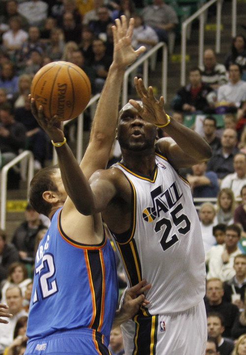 Rick Egan   |  The Salt Lake Tribune  Utah Jazz forward Al Jefferson (25) gets a shot off, as Oklahoma City Thunder's Nenad Krstic (12)  defends, in NBA action, Utah Jazz vs. Oklahoma Thunder, in Salt Lake City,  Saturday, February 5, 2011