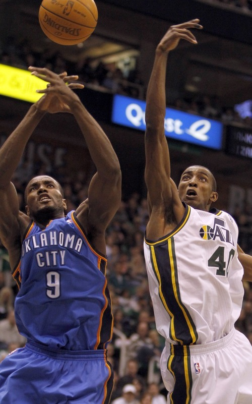 Rick Egan   |  The Salt Lake Tribune  Oklahoma City Thunder's Serge Ibaka (9)  and Utah Jazz forward Jeremy Evans (40) go for a rebound, in NBA action, Utah Jazz vs. Oklahoma Thunder, in Salt Lake City,  Saturday, February 5, 2011