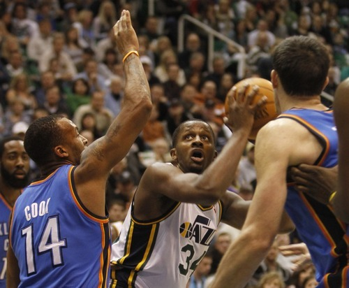 Rick Egan   |  The Salt Lake Tribune  Utah Jazz guard Earl Watson (11)  looks for a shot, as Oklahoma City Thunder's Daequan Cook (14) defends, in NBA action, Utah Jazz vs. Oklahoma Thunder, in Salt Lake City,  Saturday, February 5, 2011