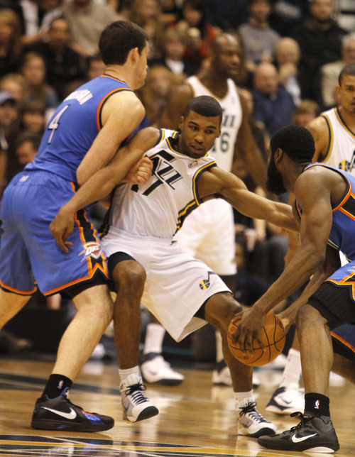 Rick Egan   |  The Salt Lake Tribune  Utah Jazz guard Ronnie Price (17) is held by Oklahoma City Thunder forward Nick Collison (4) in NBA action, Utah Jazz vs. Oklahoma Thunder, in Salt Lake City,  Saturday, February 5, 2011