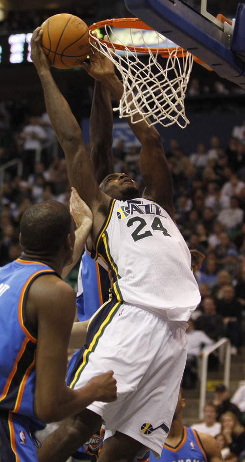 Rick Egan   |  The Salt Lake Tribune  Utah Jazz forward Paul Millsap (24) is fouled as he goes up for a shot, in NBA action, Utah Jazz vs. Oklahoma Thunder, in Salt Lake City,  Saturday, February 5, 2011