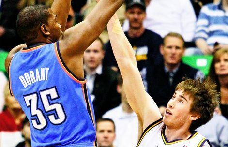 Rick Egan   |  The Salt Lake Tribune  Oklahoma City's Kevin Durant, left, shoots over Utah's Gordon Hayward, during the Thunder's victory over the Jazz on Saturday night. Durant finished with 21 points against the Utah defense.