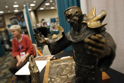 Francisco Kjolseth  |  The Salt Lake Tribune Michele Vandenheuvel of New Mexico displays her bronze sculpures as some 1,200 Catholics from the United States, Canada and Guam gathered recently for the Southwest Liturgical Conference Study Week at the Salt Palace in Salt Lake City.
